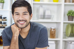 Handsome Smiling Asian Man With Beard. Portrait of handsome smiling young Asian man with a beard in a kitchen at home stock images