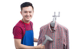 Handsome smiling asian man doing housework. Isolated over white. Handsome smiling asian man doing housework. Isolated over white Royalty Free Stock Image