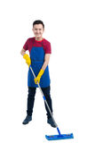 Handsome smiling asian man doing housework. Isolated over white. Handsome smiling asian man doing housework. Isolated over white Royalty Free Stock Photo