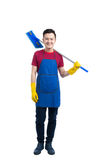 Handsome smiling asian man doing housework. Isolated over white. Handsome smiling asian man doing housework. Isolated over white Royalty Free Stock Photography