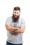 Handsome smiling bearded man standing with arms crossed Royalty Free Stock Photo