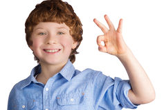 Handsome smiling boy showing OK sign with his hand Stock Photography