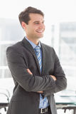 Handsome smiling businessman with arms crossed Stock Photo