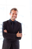 Handsome smiling businessman with folded arms Royalty Free Stock Photo