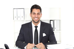 Handsome smiling businessman at his desk Royalty Free Stock Photo