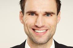 Handsome smiling businessman stock images