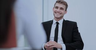 Image of young businessman communicating with his colleague. Handsome smiling businessman talking. intewiev at office Royalty Free Stock Photos