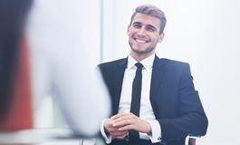 Image of young businessman communicating with his colleague. Handsome smiling businessman talking. intewiev at office Royalty Free Stock Images