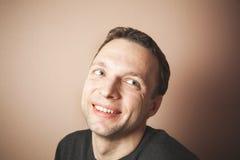 Handsome smiling Caucasian man studio portrait Stock Photos