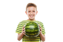Handsome smiling child boy holding green watermelon fruit. Handsome smiling child boy hand holding green ripe watermelon fruit food white isolated Royalty Free Stock Image