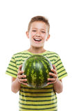 Handsome smiling child boy holding green watermelon fruit. Handsome smiling child boy hand holding green ripe watermelon fruit food white isolated Stock Images