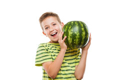 Handsome smiling child boy holding green watermelon fruit. Handsome smiling child boy hand holding green ripe watermelon fruit food white isolated Stock Photos