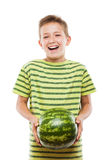 Handsome smiling child boy holding green watermelon fruit. Handsome smiling child boy hand holding green ripe watermelon fruit food white isolated Stock Photography