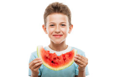 Handsome smiling child boy holding red watermelon fruit slice. Handsome smiling child boy hand holding red ripe watermelon fruit food slice white isolated Royalty Free Stock Photos
