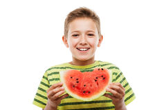 Handsome smiling child boy holding red watermelon fruit slice royalty free stock photography