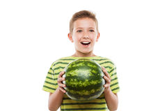 Handsome smiling child boy holding green watermelon fruit. Handsome smiling child boy hand holding green ripe watermelon fruit food white isolated Stock Image