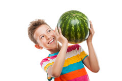 Handsome smiling child boy holding green watermelon fruit. Handsome smiling child boy hand holding green ripe watermelon fruit food white isolated Royalty Free Stock Images