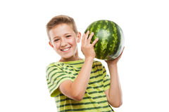 Handsome smiling child boy holding green watermelon fruit. Handsome smiling child boy hand holding green ripe watermelon fruit food white isolated Royalty Free Stock Photo