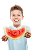 Handsome smiling child boy holding red watermelon fruit slice. Handsome smiling child boy hand holding red ripe watermelon fruit food slice white isolated Stock Photos