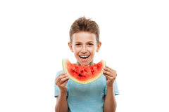 Handsome smiling child boy holding red watermelon fruit slice. Handsome smiling child boy hand holding red ripe watermelon fruit food slice white isolated Royalty Free Stock Photography