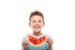 Handsome smiling child boy holding red watermelon fruit slice. Handsome smiling child boy hand holding red ripe watermelon fruit food slice white isolated Royalty Free Stock Images