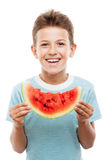 Handsome smiling child boy holding red watermelon fruit slice stock image