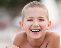 Handsome smiling child boy taking sunbath Stock Images