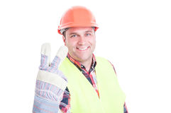 Handsome smiling constructor counting two Royalty Free Stock Photo