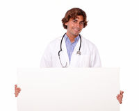 Handsome smiling doctor with blank placard Stock Images