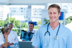 Handsome smiling doctor looking at camera Stock Images