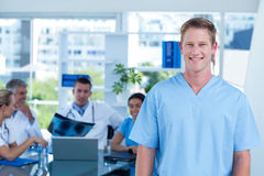 Handsome smiling doctor looking at camera Royalty Free Stock Photo