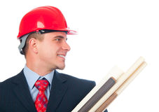 Handsome smiling engineer with hard hat on his hea. D and blueprints in his arms isolated on white Stock Photos