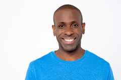 Handsome smiling guy in casual attire. Happy middle aged african model Royalty Free Stock Image