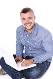 Handsome smiling guy with laptop royalty free stock images