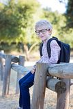 Back to school. Handsome smiling little boy in glasses with backpack ready for school, back to school concept Royalty Free Stock Photo