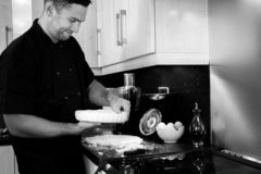 Good looking male chef presses pastry into a dish royalty free stock photo