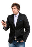 Handsome smiling man with cell phone Royalty Free Stock Photo