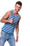 Handsome smiling man gives thumbs up Royalty Free Stock Photos