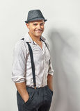 Handsome smiling man in hat and suspenders royalty free stock photos