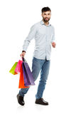 Handsome smiling man holding shopping bags Royalty Free Stock Photo