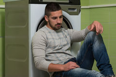 Handsome Smiling Man In The Laundry Room Royalty Free Stock Photos