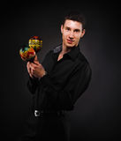 Handsome smiling man with maracas Royalty Free Stock Photography