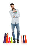 Handsome smiling man with shopping bags and holding credit card Stock Photo
