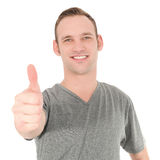 Smiling man showing thumb up Royalty Free Stock Photography