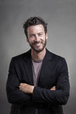 Handsome smiling man smiling wearing grey suit Royalty Free Stock Image