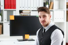 Handsome smiling man in suit and tie stand in office. Looking in camera portrait. White collar dress code modern lifestyle graduate college study profession Stock Photography