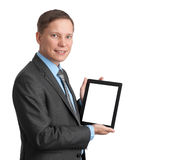 Handsome smiling man with tablet computer Royalty Free Stock Photo