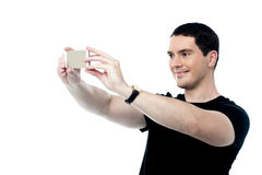 Handsome smiling man taking a selfie Stock Photography