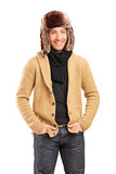 Handsome smiling man wearing fur hat Stock Photo
