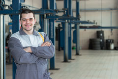Handsome smiling mechanic. Royalty Free Stock Photos